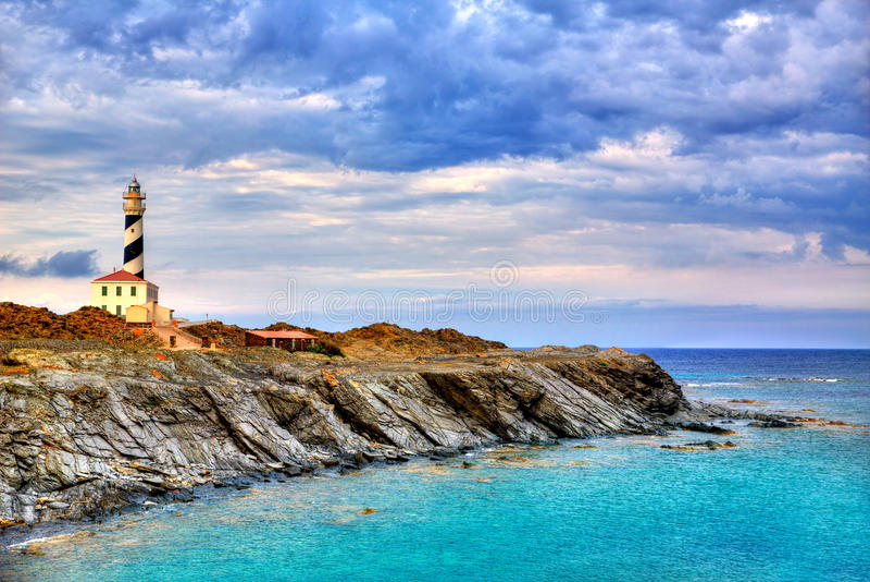 Cap de Favaritx日落灯塔海角在马翁 免版税库存照片