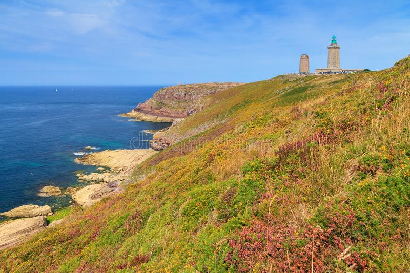 Cap frehel coastline. Beautiful landscape view of the cliffs at Cap Fréhel in Brittany, France, with its lighthouses and moorland with vibrant heather flowers royalty free stock photos