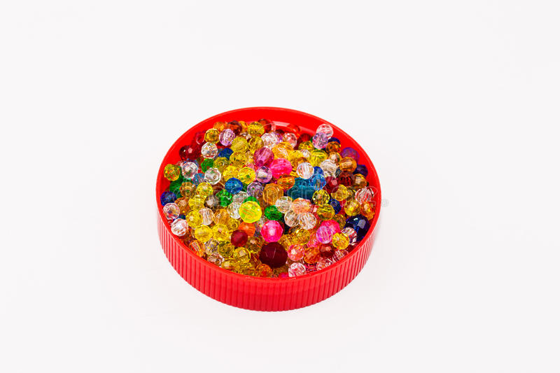 Cap full of multi colored beads royalty free stock photo