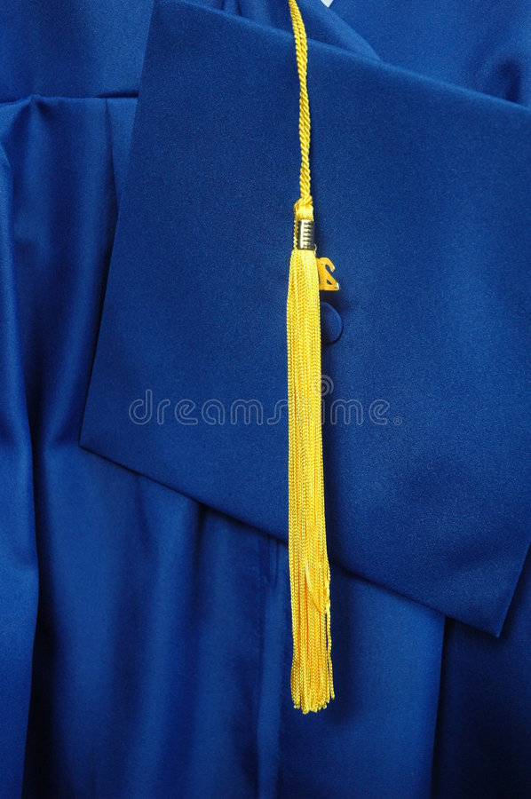 Cap, Gown, and Tassel. A graduates cap, gown, and tassel awaits the big moment royalty free stock image