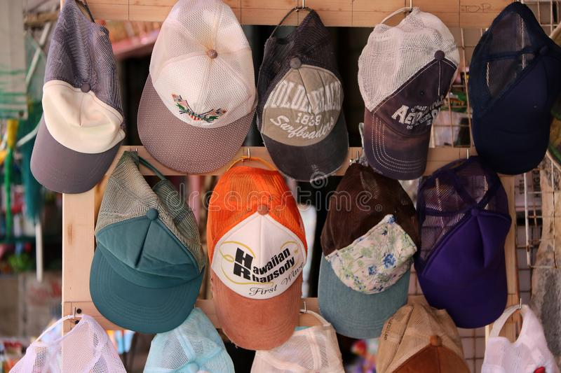 Cap hanging on the shelf display for sale in the local market. royalty free stock photography