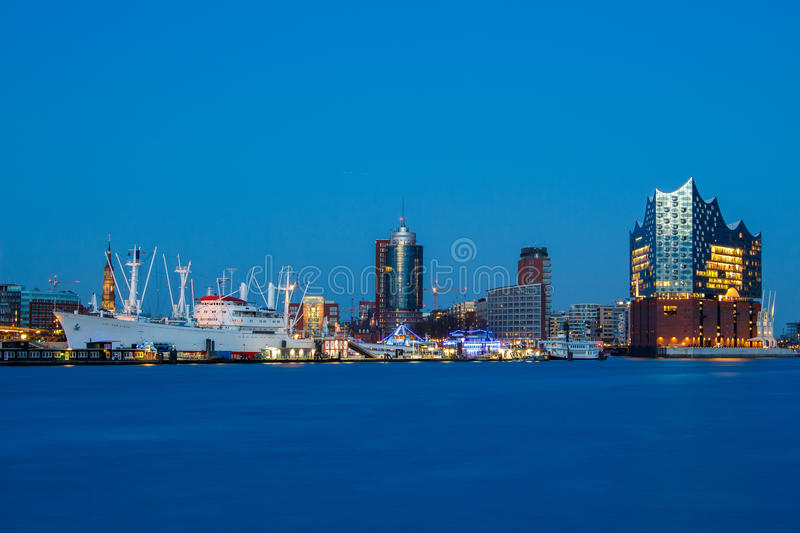 Cap San Diego and Elbphilharmonie Hamburg at blue hour. Panoramic view of the port of Hamburg at blue hour with museum ship Cap San Diego and Elbphilharmonie royalty free stock photography