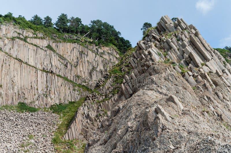 Cap Stolbchaty, cap géographique sur le rivage est de l'île de Kunashir de Sakhaline Oblast, Russie photos stock