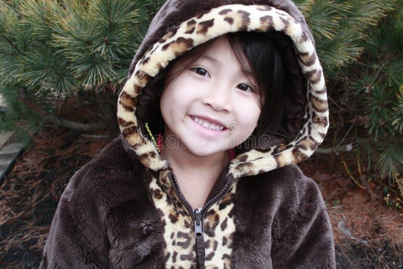 Capa de sorriso da menina asiática fotografia de stock