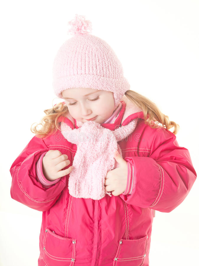 Capa del invierno de la niña que desgasta fotografía de archivo