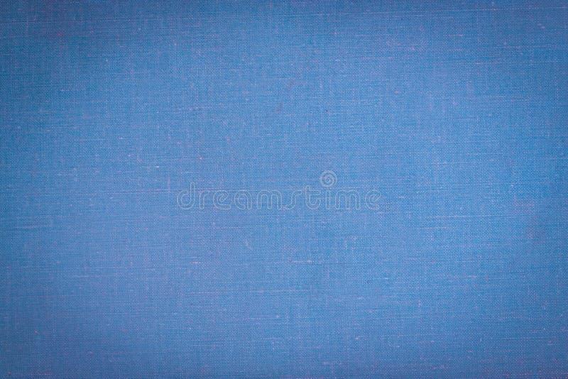Capa do livro de pano do vintage com um fundo do teste padrão e do grunge da tela azul fotos de stock royalty free