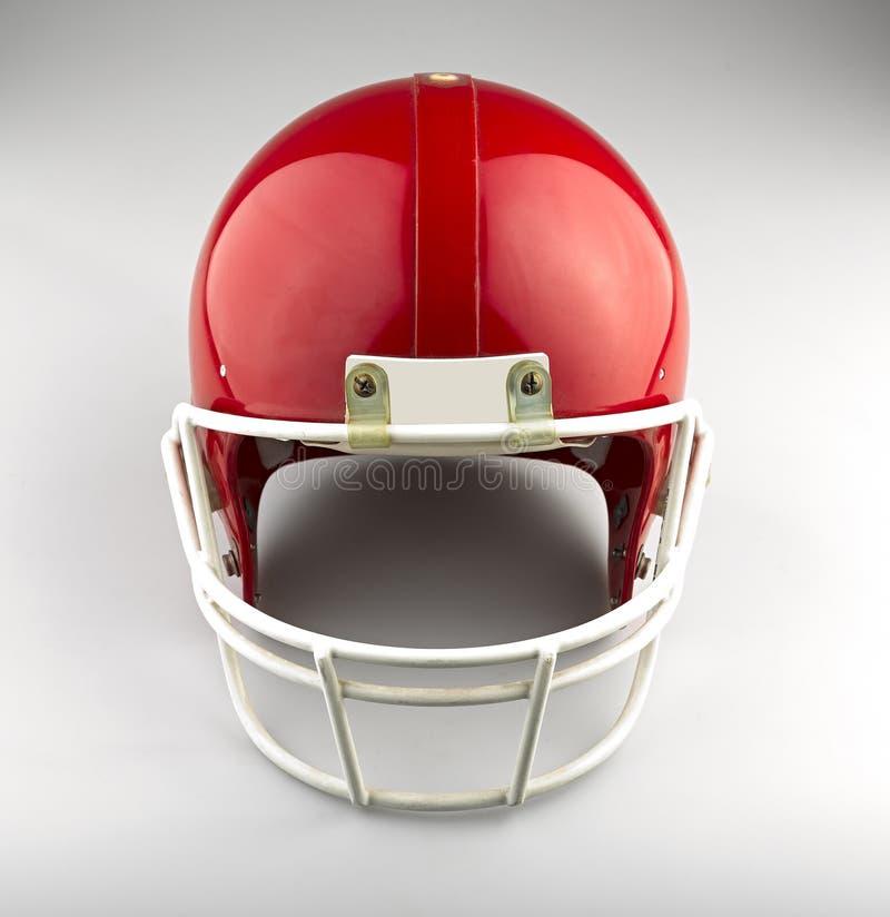 Capacete de futebol americano vermelho fotografia de stock royalty free