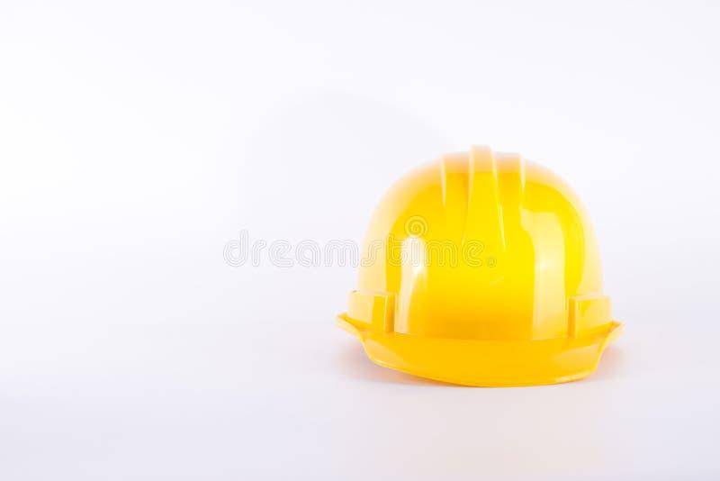Capacete de segurança amarelo no fundo branco Capacete de segurança isolado em w imagens de stock royalty free