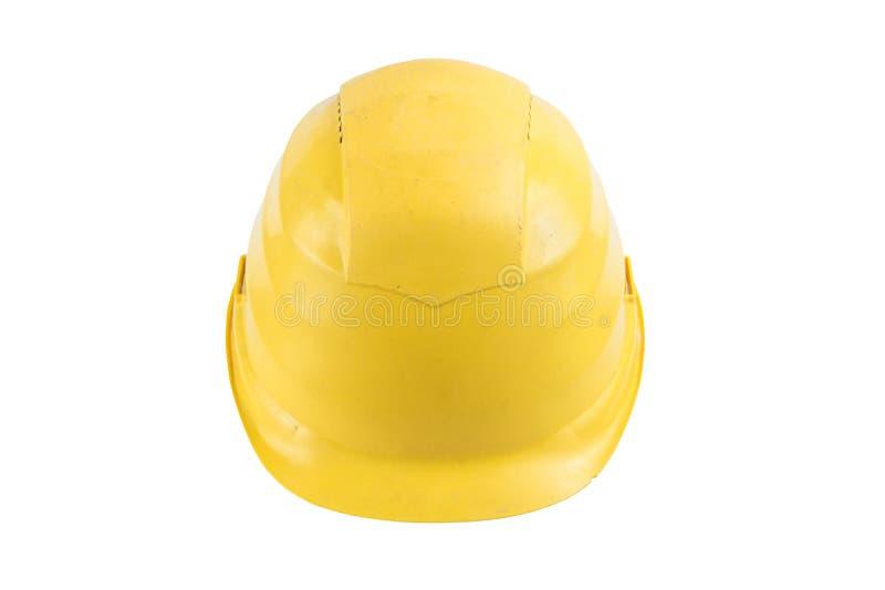 Capacete de segurança amarelo usado isolado no fundo branco Trajeto de grampeamento salvar Capacete da proteção, equipamento de c fotografia de stock royalty free
