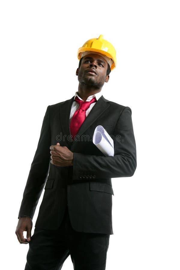 Capacete de segurança do amarelo do coordenador do arquiteto do americano africano imagens de stock