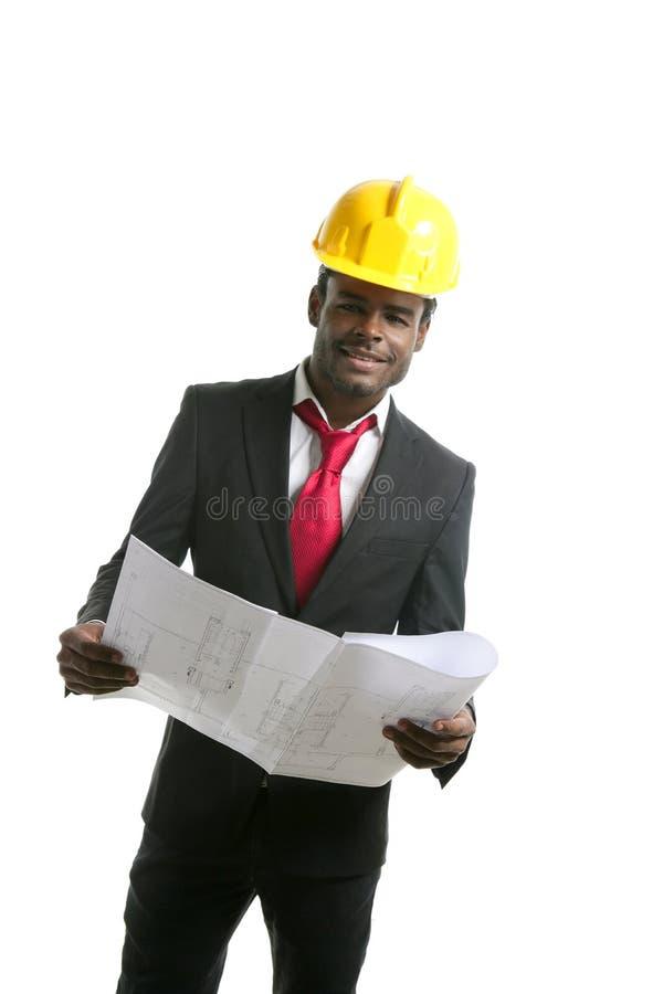 Capacete de segurança do amarelo do coordenador do arquiteto do americano africano imagem de stock royalty free