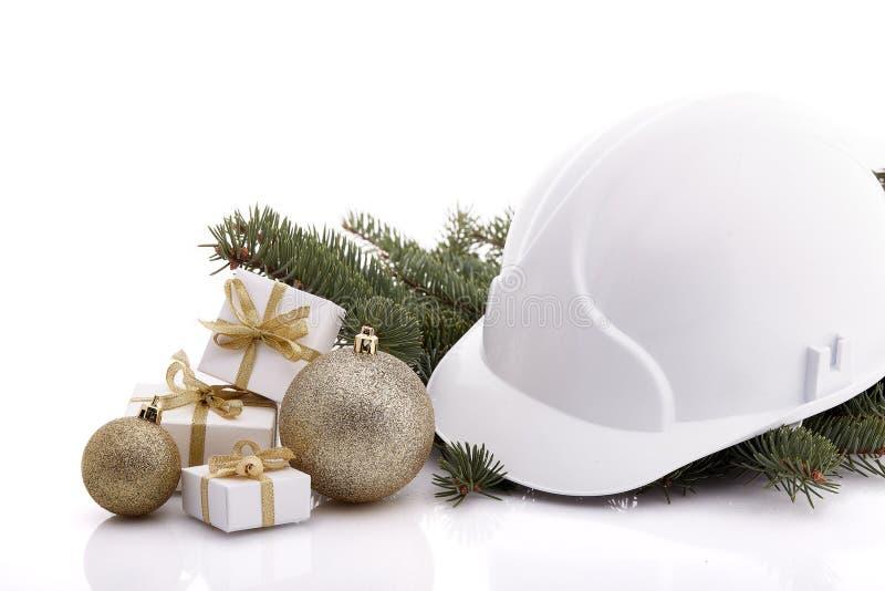 Capacete de segurança e Natal da construção fotos de stock royalty free