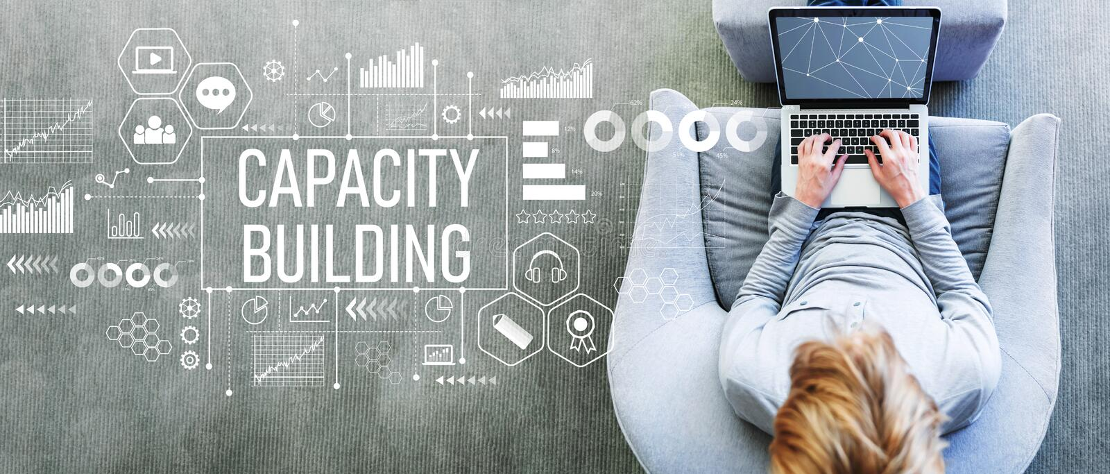 Capacity building with man using a laptop royalty free stock photo