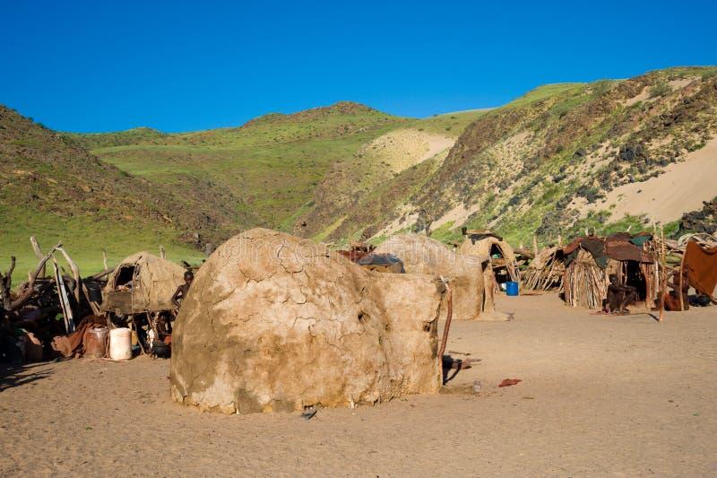 Capanne della tribù di Himba in Namibia immagine stock