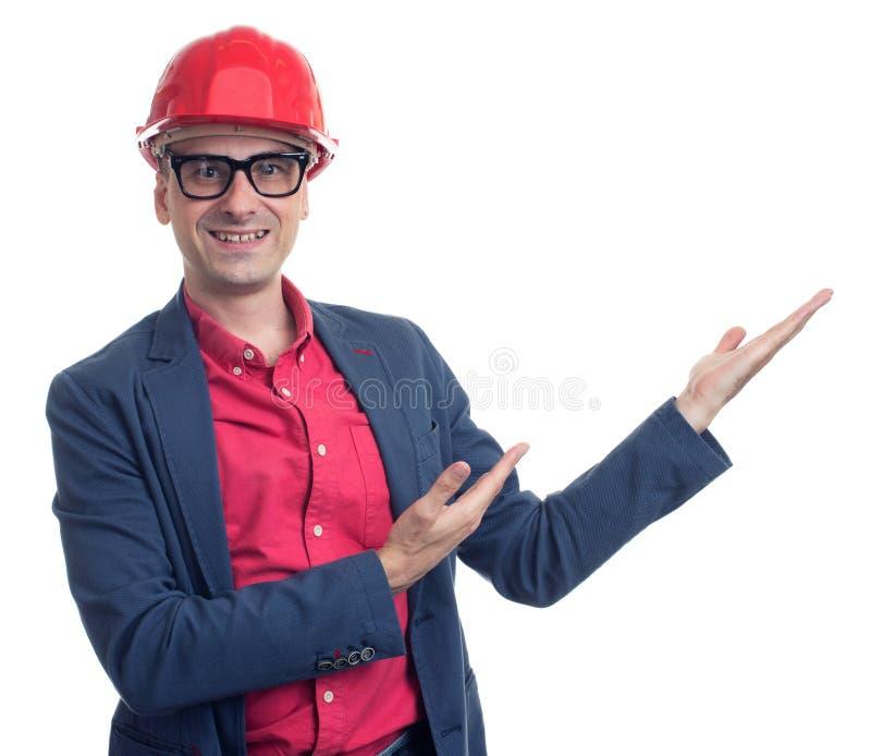 Capataz joven con el casco Aislado fotos de archivo