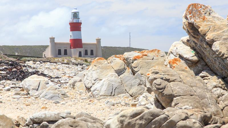 Lighthouse Cape Agulhas in South Africa. The Cape Agulhas lighthouse is situated at the southern most tip of Africa, built in the 1848. The lighthouse was built royalty free stock photo
