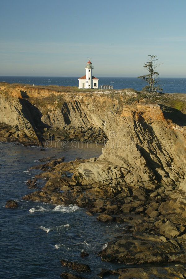 Cape Arago lighthouse 2. View of Cape Arago lighthouse at sunset stock image
