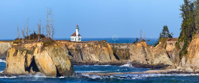 Cape Arago Lighthouse on the Oregon Coast. Cape Arago Lighthouse panorama on the Oregon Coast stock photo