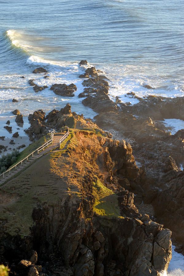 Cape Byron in morning sunrise. Cape cliff ocean sea wave morning sunrise dawn stock image