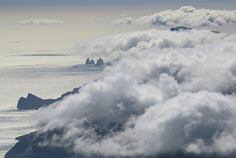 Hidden capri. The cape campanella and the faraglioni rocks of capri island hidden from the clouds royalty free stock image