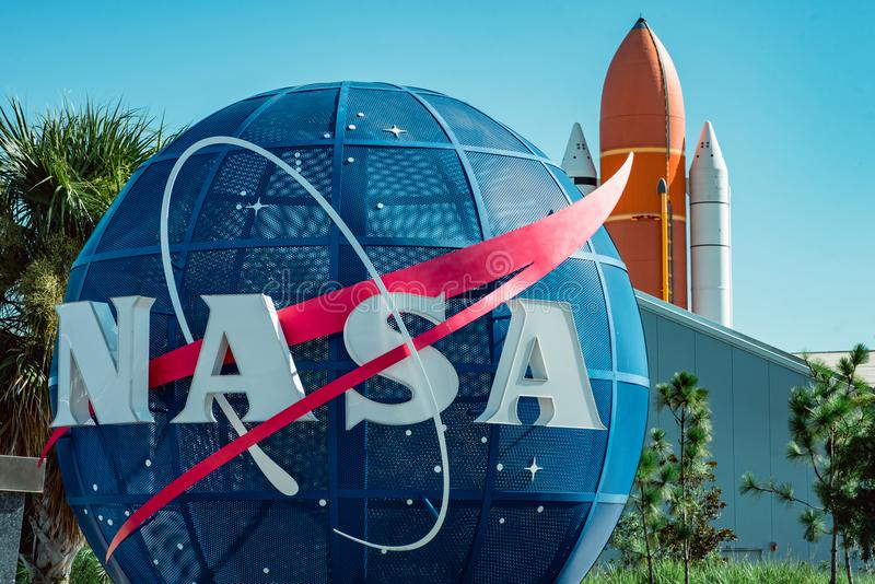 Cape Canaveral, Florida - August 13, 2018: NASA globe with space shuttle booster rocket in backgrond at NASA Kennedy royalty free stock photo