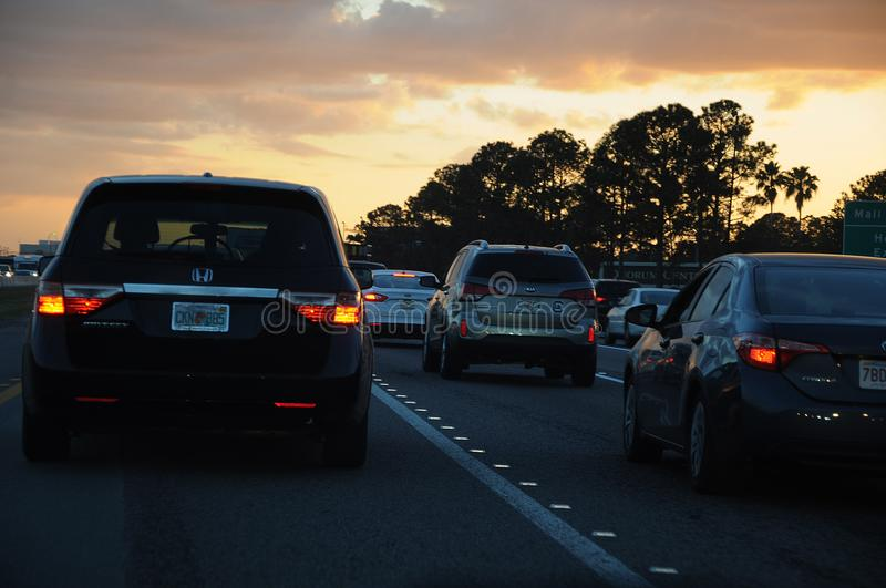 FLORIDA TRAFFIC DURING SUNSETS. CAPE CANAVERAL / FLORIDA / USA - 06 December 2017.-Florida jam traffic during sunsets stock photography