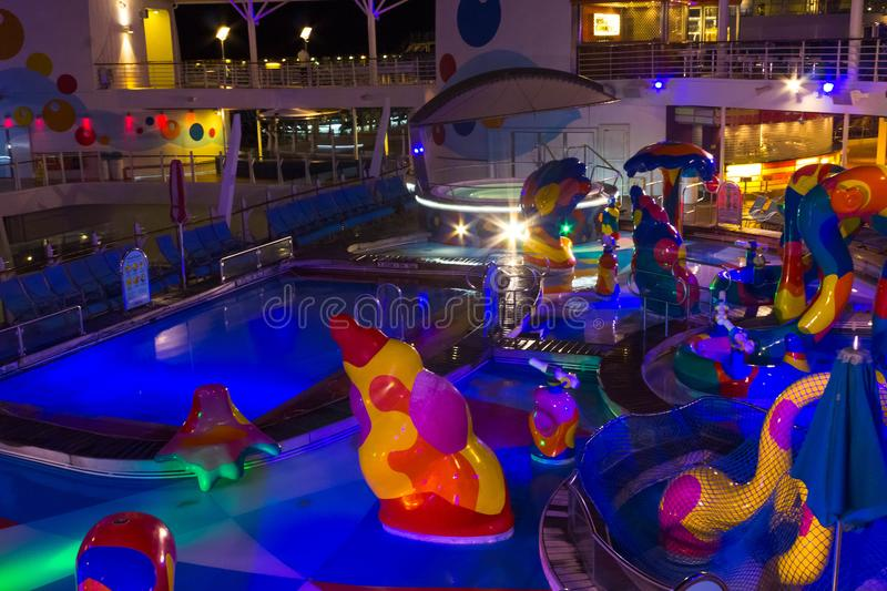 Cape Canaveral, USA - May 06, 2018: Open deck in the night time. Giant cruise ship Oasis of the Seas by Royal Caribbean. royalty free stock images