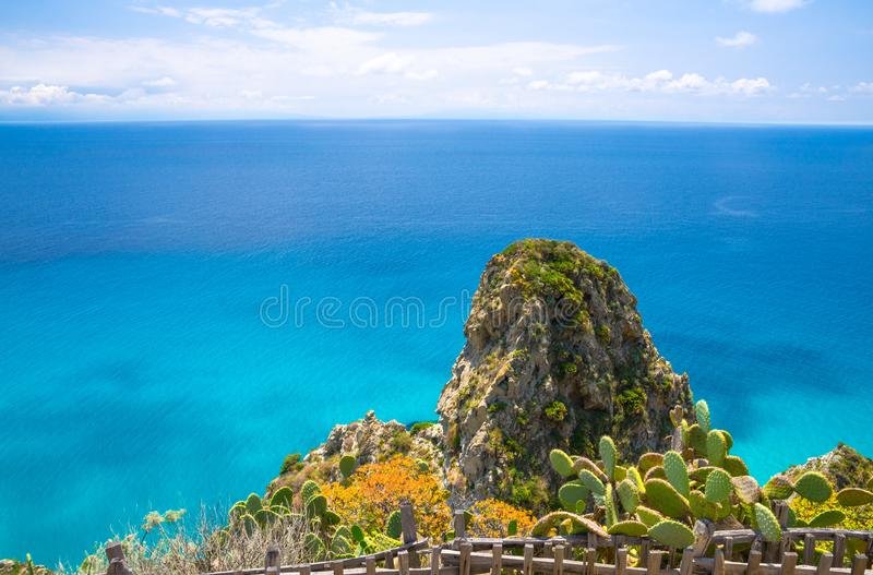 Cape Capo Vaticano aerial panoramic view, Calabria, Southern Italy. Cape Capo Vaticano Ricadi aerial panoramic view from cliffs platform with green rock hill royalty free stock images