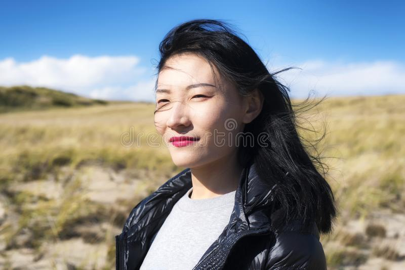 Cape Cod National Seashore Nature woman. A chinese woman contemplating her thoughts outside on a sunny windy day on the cape cod national seashore in Truro royalty free stock images