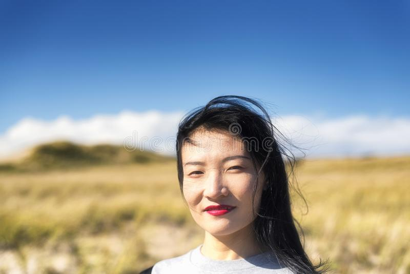 Cape Cod National Seashore Nature woman. A chinese woman outside on a sunny windy day on the cape cod national seashore in Truro Massachusetts royalty free stock images