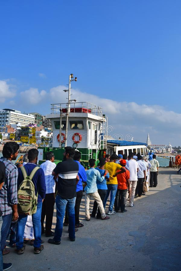 Cape Comorin Kanyakumari, India, West Bengal Tamil Nadu, March, 15, 2019. People stand in line for the ferry.India.  Small tow. Cape Comorin Kanyakumari, India royalty free stock images