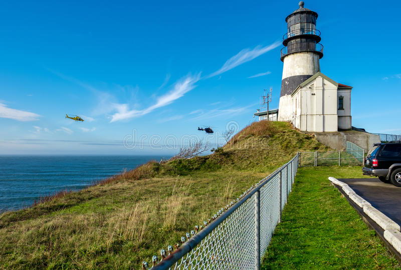 Cape Disappointment Lighthouse. Coast guard helicopters in the sky. Cape Disappointment Lighthouse, built in 1856, Pacific coast, WA, USA. Coast guard royalty free stock photo