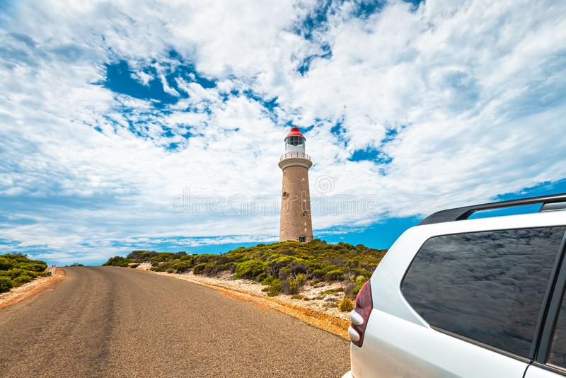 Cape Du Couedic lighthouse by the road with SUV driving by royalty free stock photos