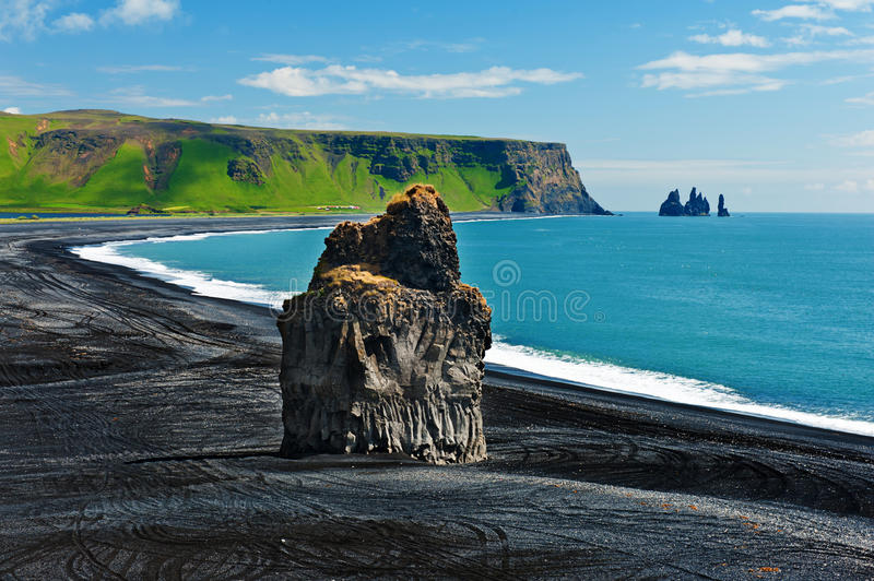Cape Dyrholaey. Beautiful rock formation on a black volcanic beach at Cape Dyrholaey, the most southern point of Iceland royalty free stock photos