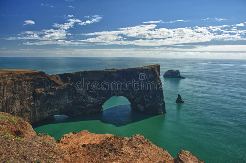 Cape Dyrholaey. Is the most southern point of Iceland. It is known for its massive gate made by volcanism royalty free stock images