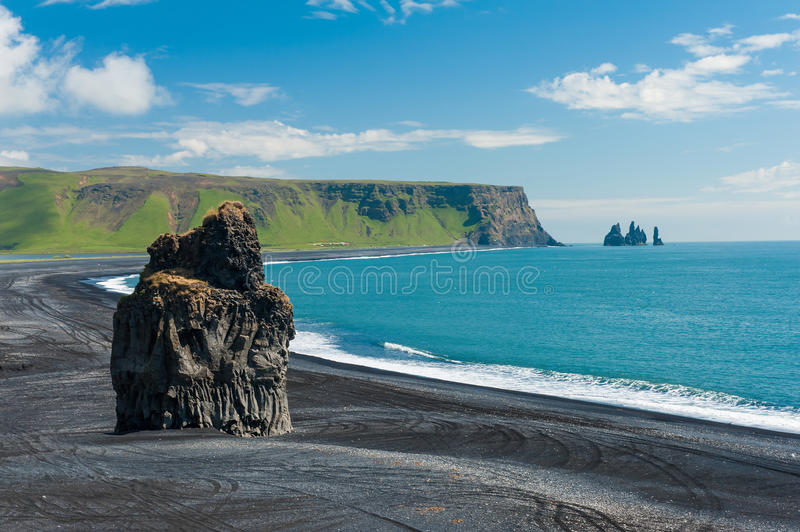 Cape Dyrholaey. Beautiful rock formation on a black volcanic beach at Cape Dyrholaey, the most southern point of Iceland royalty free stock image