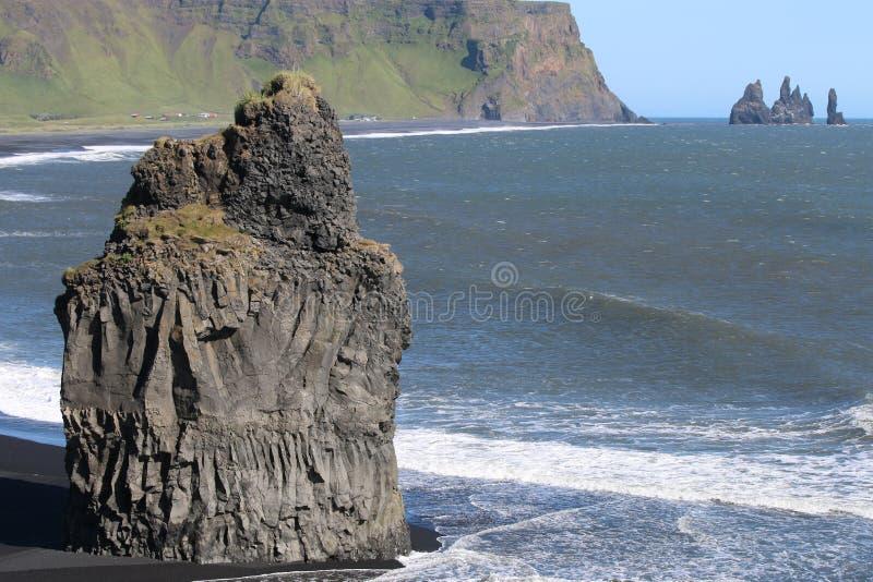 Cape Dyrholaey. Rock pillar at the beach of Dyrholaey near Vik. Southern coast of Iceland stock image