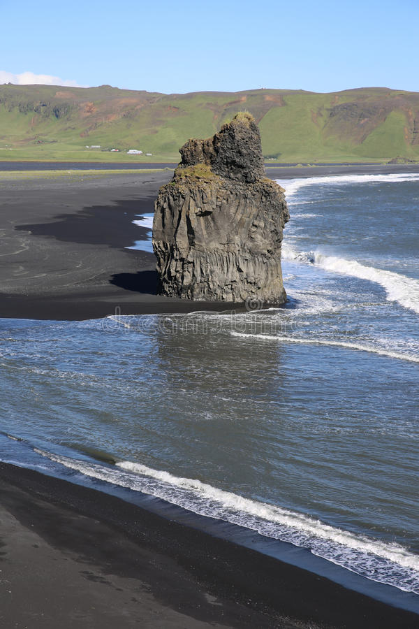Cape Dyrholaey. Rock pillar at the beach of Dyrholaey near Vik. Southern coast of Iceland royalty free stock photo