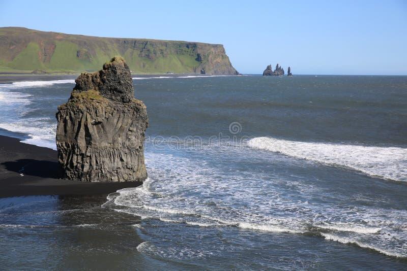 Cape Dyrholaey. Rock pillar at the beach of Dyrholaey near Vik. Southern coast of Iceland royalty free stock image