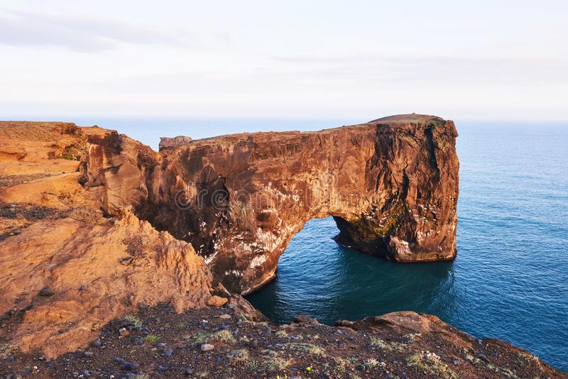 Cape Dyrholaey at southern Iceland. Altitude 120 m, and mean hill island with a door opening stock photo