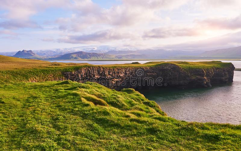 Cape Dyrholaey at southern Iceland. Altitude 120 m, and mean hill island with a door opening royalty free stock photography