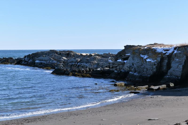 Cape Elizabeth`s rocky shoreline, Cape Elizabeth,Cumberland County, Maine,  US. A clear sunny cold winter day along the rocky shoreline at Dyer Cove on stock photos