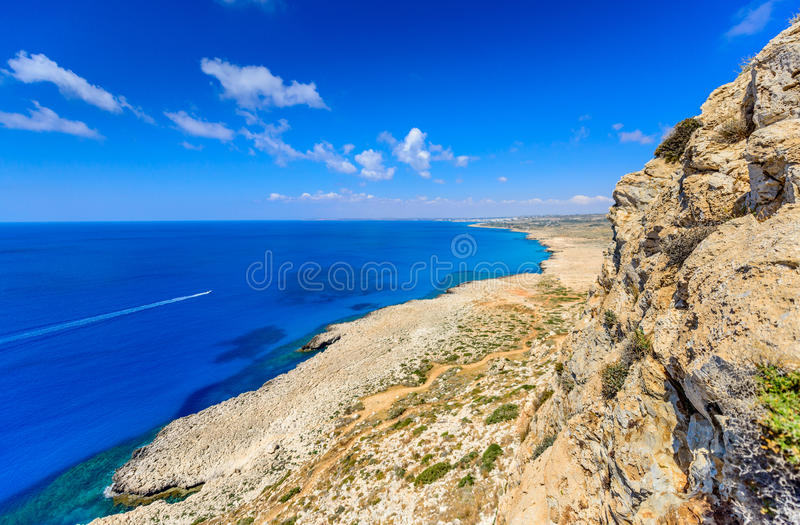 Cape greco view 7. An early summer day at cape greco in cyprus,from a high view pont with a hiking path leading from the rocky headland and sea in the back stock photo