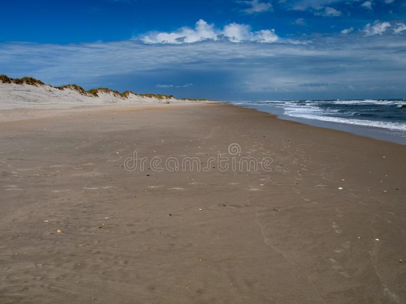 Cape Hatteras National Seashore in North Carolina. Cloudy skies over the ocean at Cape Hatteras National Seashore located on the North Carolina Outer Banks and stock photo