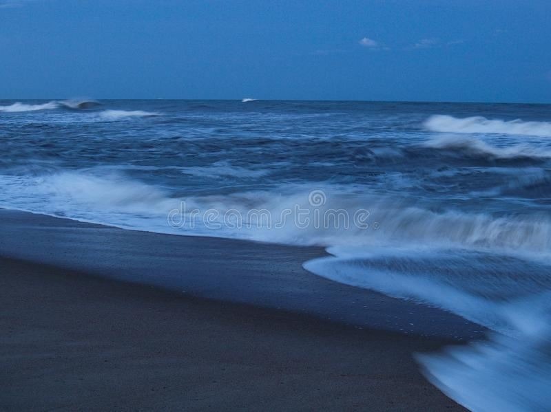 Cape Hatteras National Seashore in North Carolina. Evening skies over the ocean at Cape Hatteras National Seashore located on the North Carolina Outer Banks and stock photos