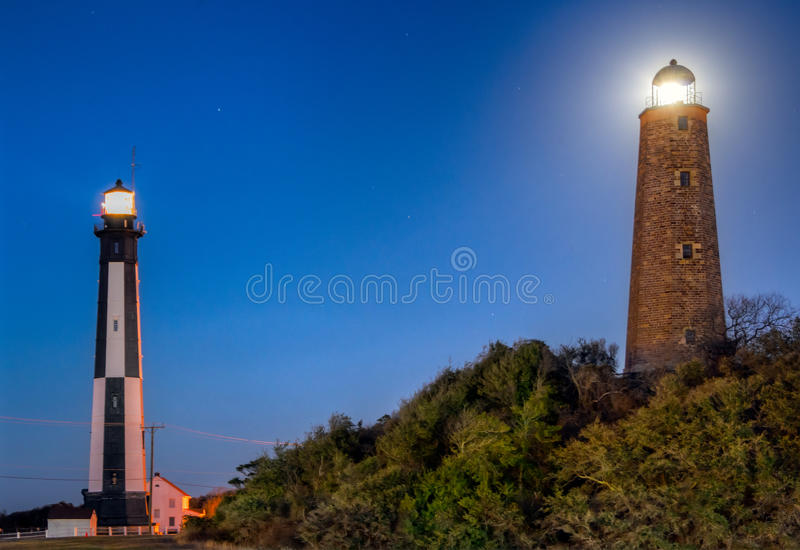 Cape Henry Lighthouses. Image of the new and the old Cape Henry Lighthouses located at the mouth of the Chesapeake Bay situated on Fort Story in beautiful stock images