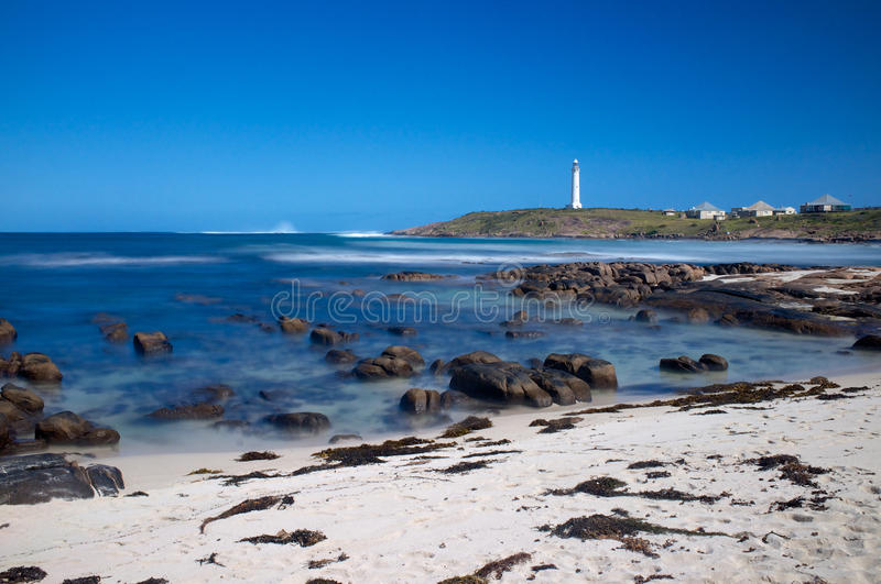 Cape Leeuwin Lighthouse, Western Australia. The Cape Leeuwin Lighthouse is a lighthouse located on the headland of Cape Leeuwin, the most south-westerly point on royalty free stock photo