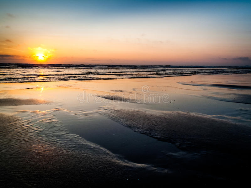 Cape Lookout sunset at low tide stock photography