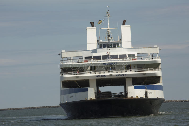 Cape May ferry boat turns into dock at Lewes, Delaware. LEWES, DELAWARE, USA - MARCH 7, 2017: Bow of the Cape May ferry, `Delaware,` as it nears the dock at stock photos