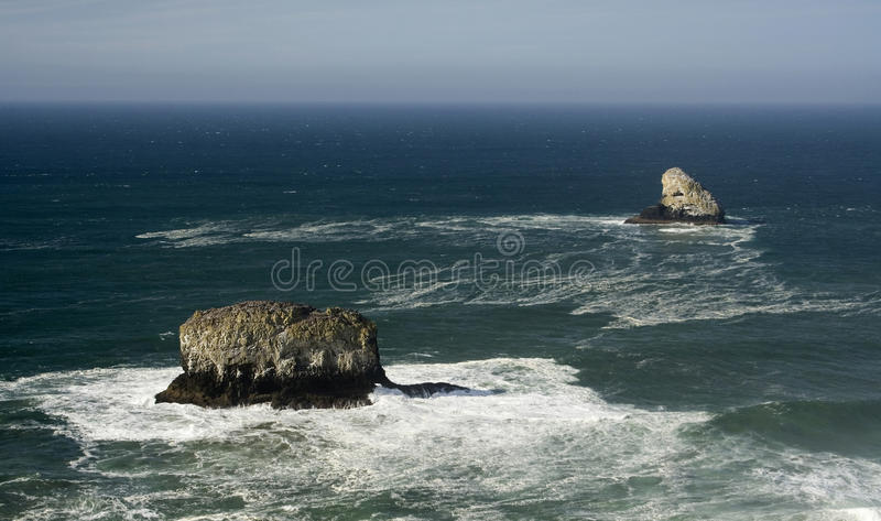 Cape Meares. Beautiful ocean view with crushing waves and giant rocks on the Oregon Coast in the fall royalty free stock images